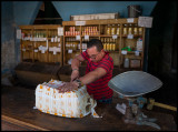 Cutting a fresh delivery of cheese - Camagüey