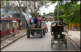 City traffic with tractor and horse cart