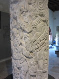 Column depicting Maya Court life - the ruler is watching a dwarf dance and two trumpeters play