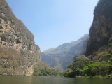 The boat winds its way through the canyon...