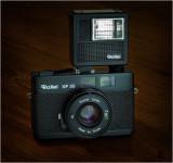 Rollei XF35, f2.3 40mm Sonnar (c1974) with Rollei 100 XL flash.