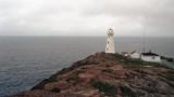 Lighthouse under the fog