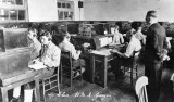 1949-56 - BOY TELS TAKING PART IN A W.T. MORSE TYPING EXERCISE OVERSEEN BY A C.C.O.(W).