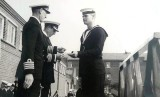 1957, JANUARY - BOB HOOKWAY, RECEIVING RUGBY COLOURS FROM CAPT. RD FRANKS, WITH CDR. McCRUM..jpg