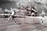 1962, 14TH FEBRUARY - JOHN WABY, COLLINGWOOD, 56 CLASS ,36 MESS, WINNING THE HURDLES..jpg