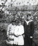 1962 - WILLIAM THORNHAM, MUM INSISTED POSING WITH MY SISTERS.jpg