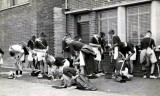 RH - PUZZLE PHOTO - WHAT IS GOING ON, MAYBE ISSUE OF RUGBY BOOTS..jpg
