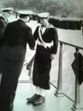 1971 - GARY BLANKSBY, ACCEPTING PRINCIPLE DRUMMER'S SASH FROM CAPT. BUTTON..jpg