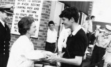 1971, 1ST NOVEMBER - PETER DAVID, PRESENTING MRS ASH, CO'S WIFE, WITH FLOWERS AFTER REGATTA..jpg