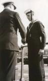 1961 - JOHN McPHERSON, RECEIVING FOOTBALL COLOURS FROM COMMANDER GAUNT..jpg