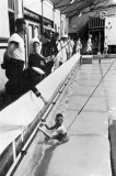 UNDATED - LESSON IN OLD SWIMMING POOL, NOTE LINE AROUND WAIST.jpg