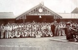 UNDATED - GROUP PHOTO OF BOYS IN DUCK SUITS AT TOP OF LONG COVERED WAY.jpg
