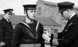 1949, JANUARY - DICK HALE, STAR OF THE FILM A SAILOR IS BORN, BEING RATED INSTRUCTOR BOY