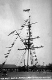 1922, 6TH MAY - MAST DRESSED OVERALL FOR ACCESSION DAY WITH BOYS ALOFT.