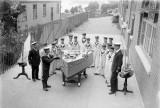 1914-1918 - OUTSIDE THE SEAMANSHIP SCHOOL BOYS UNDER INSTRUCTION WITH PART SHIP MODEL.jpg
