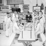 1914-1918 - SEAMANSHIP SCHOOL BOYS RECEIVING INSTRUCTION ABOUT SPLICING OF ROPES.jpg