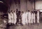 UNDATED - SEAMANSHIP SCHOOL, EARLY PHOTO SHOWING BOYS RECEIVING INSTRUCTION ON A LUG SAIL CUTTER.jpg
