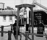 UNDATED - THE QUARTER DECK, SHOWING THE SHIP'S BELL FROM HMS IMPREGNABLE AND THE ENTRANCE TO THE LCW.jpg