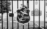 UNDATED - BADGE ON MAIN GATE.jpg