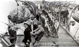 UNDATED - HAULING IN THE BOATS ON THE PIER.jpg