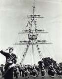 UNDATED - THE BAND IN FRONT OF A MANNED MAST.jpg