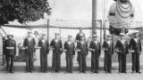 UNDATED - AN EARLY PHOTO OF BOY BUGLERS UNDER THE MAST WITH THEIR INSTRUCTOR.JPG