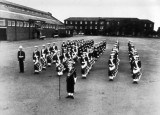 UNDATED - THE BUGLE AND DRUM BAND ON THE PARADE GROUND.jpg