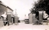 1937- PHILIP ANTHONY (TONY) FOSTER POST CARD SHOWING MAIN GATE AND GUARDHOUSE.jpg