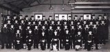 c1950s - BOYS WITH THEIR DO, SUB. DO., INSTRS., RM SGT., ALL BUT 3 ARE CALL BOYS, BY PHOTOKRAFT OF IPSWICH.jpg