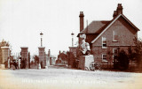 UNDATED - EARLY PHOTO OF THE SICK BAY GATES, TRAFALGAR FIGURE HEAD IN FRONT OF THE SISTERS QUARTERS. NOTE THE MILK CHURN
