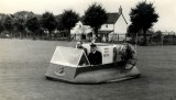 1967 - LT.CDR. STILES AND CPO JENKINS IN A HOVERCRAFT.jpg