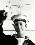 1970 - JOHN LONG WITH HIS MEDAL AS BUTTON BOY FOR THE CERMONIAL MANNING OF THE MAST.jpg