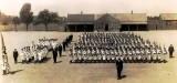 PRE 1939 - DICKIE DOYLE, PARADE SQUARE, IN THE BACKGROUND IS THE BOYS CANTEEN.jpg