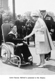 1961 - JNR. HELLIWELL MEETS THE QUEEN. HE WAS SELECTED TO BE BUTTON BOY BUT DAMAGED HIS ANKLE IN A REHEARSAL.jpg