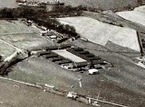 1940s - DICKIE DOYLE, POST WW II AERIAL VIEW OF THE ANNEXE, NOTE RESERVE FLEET SHIPS IN TOP OF THE PHOTO.jpg