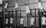 UNDATED - DICKIE DOYLE, ROPE CLIMBING IN THE GYM.jpg