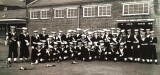 1970, SUMMER - RAY STANDLEY, THE BUGLE BAND WAITING TO PASS THROUGH NELSON ON TO THE PARADE GROUND FOR PARENTS DAY.jpg
