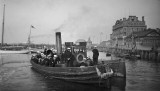 UNDATED - GANGES BOYS AND CPOs AND POs ON STEAM LAUNCH AND LARGE ROWING BOAT OFF HARWICH WATERFRONT.jpg