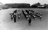 UNDATED - DICKIE DOYLE, POST WAR II, THE BAND PRACTISING ON THE PARADE GROUND.jpg
