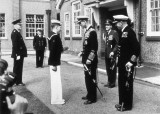 1956 - DICKIE DOYLE,  BUTTON BOY PADDY DEARNS RECEIVING HIS COIN FROM THE DUKE OF EDINBURGH WITH CAPTAIN LE FANU LOOKING ON