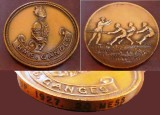 1927 - TUG OF WAR BRONZE MEDAL ~ WITH THE EDGE SHOWING 1927 AND 20 MESS.jpg