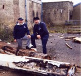 1988 - DICKIE DOYLE AND GEOFF HILL SURVEYING THE ROT TO THE MAST OUTSIDE THE OLD GENERATOR SHED.jpg