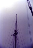 1988 - DICKIE DOYLE, ANOTHER VIEW OF THE RESTORED MAST AWAITING ITS YARDARMS.jpg