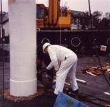 1991 - DICKIE DOYLE, REPAINTING OF MAST, GEOFF HILL PAINTING BASE OF MAST.jpg