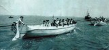 1957 - DAVE GALE, 01 RECR., HAWKE, 48 MESS, CUTTER CREW UNDER TOW, BOB HOOKWAY IS STARBOARD STROKE OAR.jpg