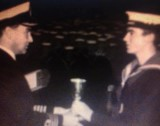 1972 - BRIAN TOMO THOMPSON, RECEIVING A TROPHY FROM CAPT. ASH.jpg