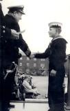 1967 - BERNARD FOSTER, RECEIVING RN BOXING COLOURS FROM CAPT. WATSON..jpg