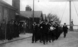 UNDATED - MARCH PAST WITH TROPHIES, THE DIAMOND SHAPE IS BEST OVERALL GYM TROPHY, DONATED BY JIM WORLDING.jpg