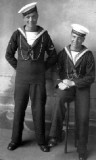 1932 - DICKIE DOYLE, PO BOY AND BOY, BOTH WITH CALL CHAINS AND THE BOY LOOKS TO HAVE A MARKSMANS BADGE..jpg