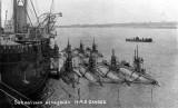 UNDATED - SUBMARINES ALONGSIDE HMS GANGES.jpg